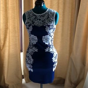 Navy blue bodycon dress with white lace overlay